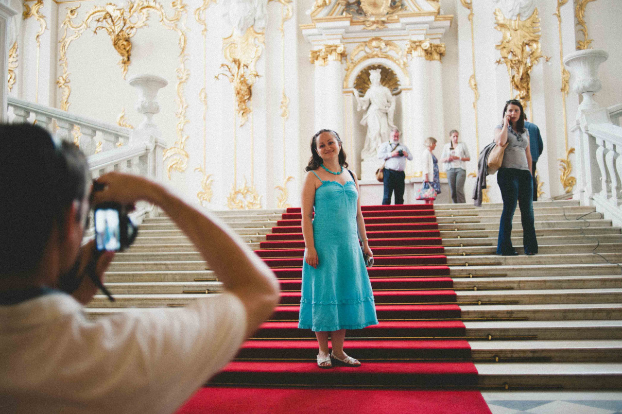 Tourists take photos during their visit to the Hermitage Museum.