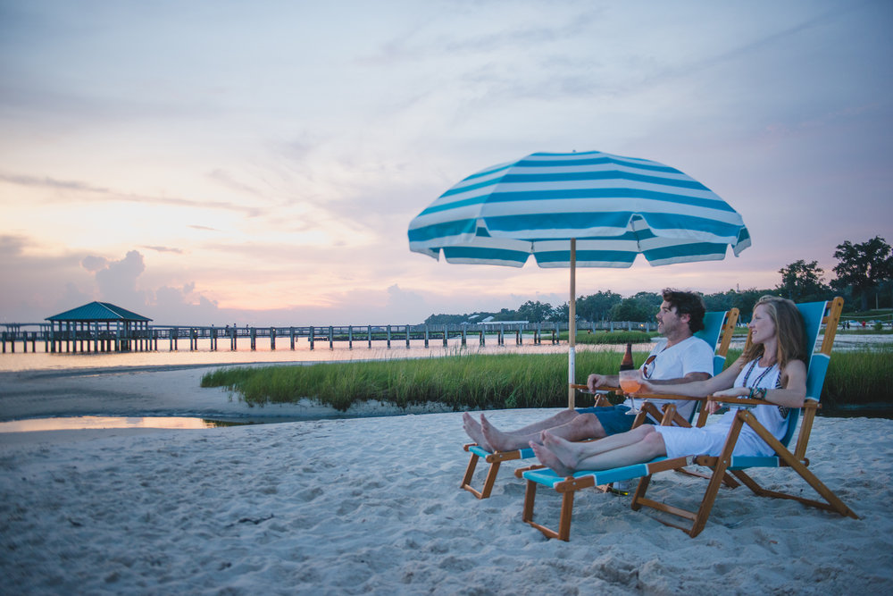 Relax! - Did you know The Inn is located just 3 BLOCKS up from Ocean Springs Front Beach? Pack the beach toys, floaties, towels, coozies, and coolers, but leave the beach chairs to us!We have partnered with local beach chair extraordinaires, Rita & Mike, of Belly Up Beach Chair Rental! Call ahead or let us know when you book your reservation, and Rita will set up a pair of beach chairs and an umbrella for you on beautiful Ocean Springs Front Beach!Just walk down to the beach and your private umbrella will be waiting for you!