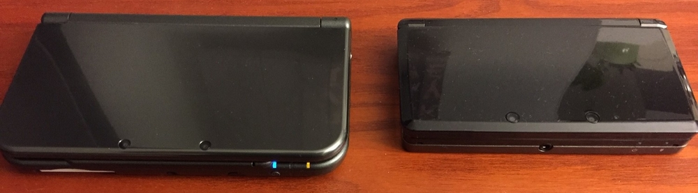 A comparison shot between the New Nintendo 3DS XL (left) and the original 3DS model (right).