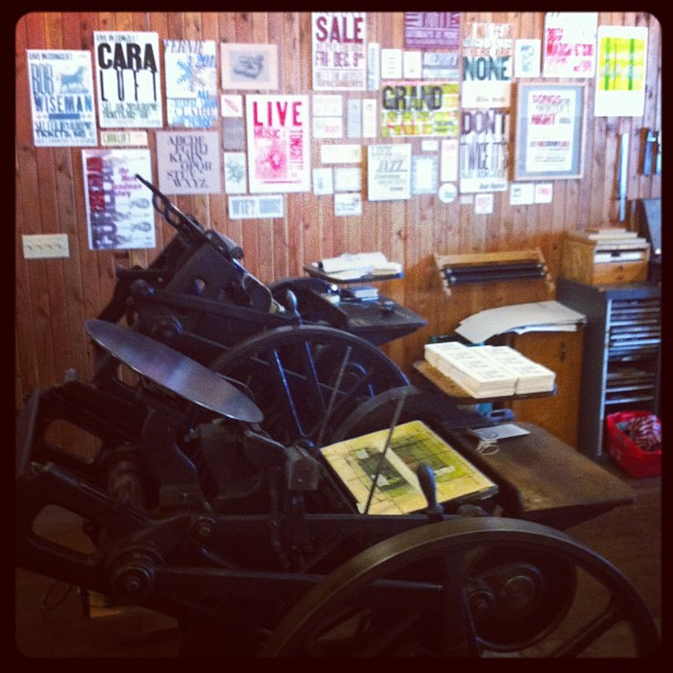 Michael's printing press and posters in background (Taken with instagram)