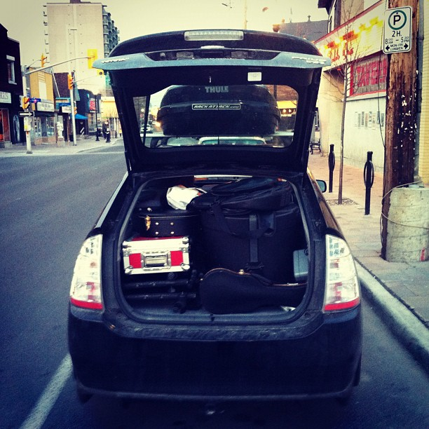 Drum kit, keyboard, guitar, banjo, ukelele, 2 amps, 3 yoga mats, 2 smoothie and fruit bags, and 3 musicians. Perhaps the tightest traveling trio on the road. (Taken with  instagram )