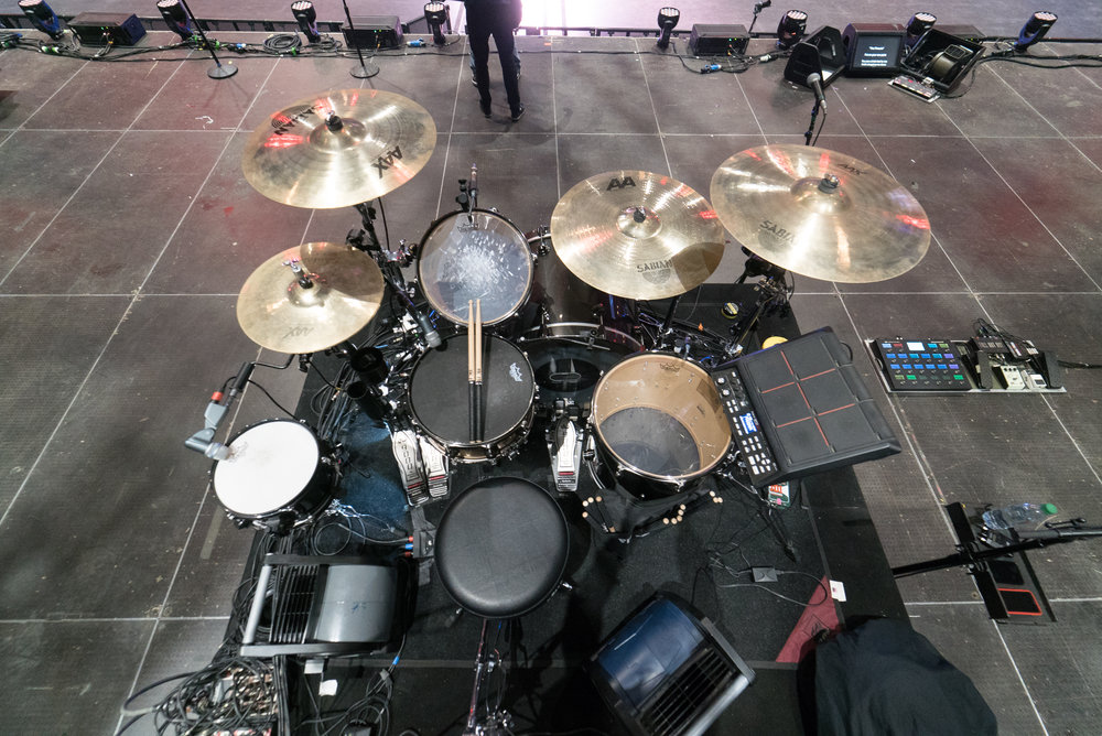 "Drum Setup-  DW Collector's Series Maple drums, metallic black lacquer, black nickel hardware, true hoops, true pitch tuning rods. 18x24 kick/9x13 rack w/STM/14x16 floor/6.5x14 snare (Black TI w/MAG throw-off).  DW Hardware-DWCP9500TB Hi-Hat/2x 9701/9991 w/SM934/9300 snare stand/DWCP9002 double pedal/9100m throne  Sabian Cymbals-20"" AAX X-Plosion Ride/19"" (FOB)-18"" (SectXVX/RT) AAX X-Plosion Crash/19"" (FOB)-18"" (SectXVX/RT) AAX X-Plosion Fast Crash/14"" AAX X-Plosion Hi-Hats  Remo Heads-13""/16"" Clear Emperor batter/13""/14""/16"" Clear Ambassador Resonant/14"" Coated Powerstroke P77/24"" Powerstroke P3 clear bass drumhead  Vic Firth Signature sticks  Roland SPD-SX pad"