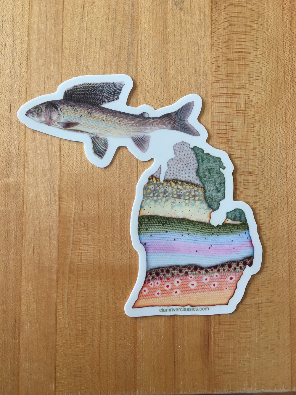 "This sticker is made from one of my drawings, which was used as the cover illustration for the book ""In Search of the Lost Grayling,"" written by my friend Kirk."