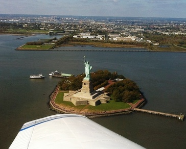 You can fly to NYC and see the Statue of Liberty from the air.