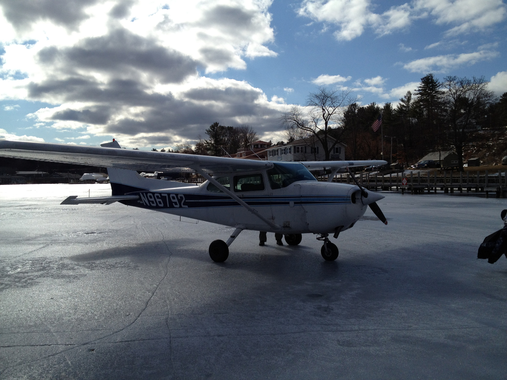 Parked after landing on the ice runway near Laconia