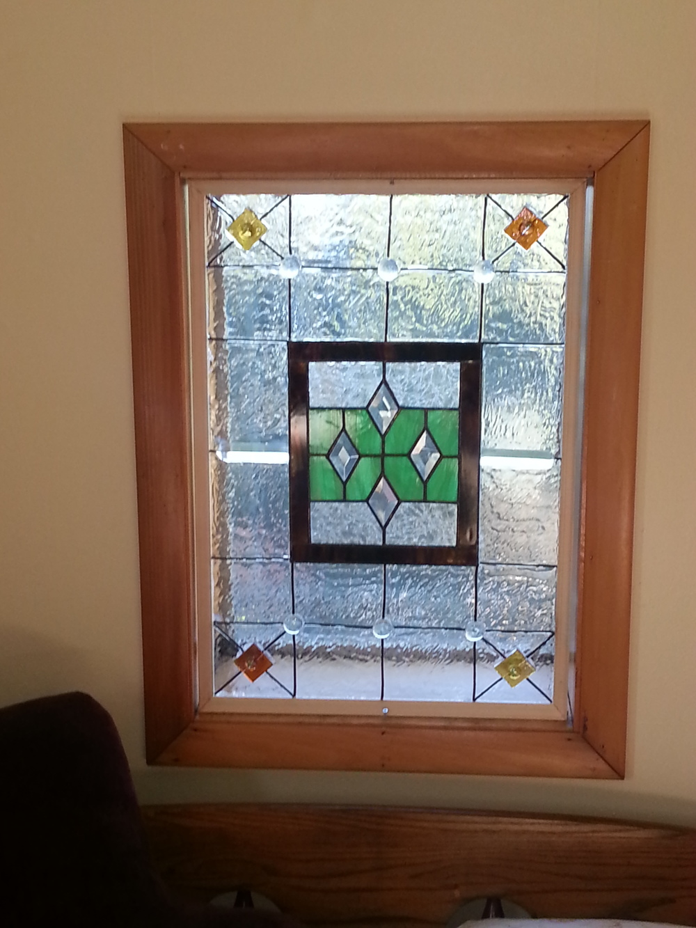 Two windows with real stained glass pieces by Jill Frederick, further embellished with glass pieces and paint.
