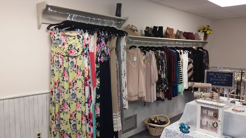 One long rack with shelf provides lots of space for hanging, then a second shelf was requested to accommodate the maxi length skirts and dresses.  See how cute these clothes are?