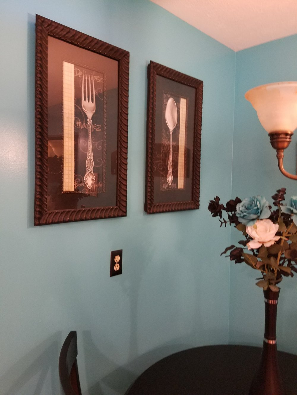 The homeowner had lovely graphic wall art of a fork and spoon.  She had considered replacing it, but it took on new life, with the bold new wall color.  The black table and chairs also pop off the color.