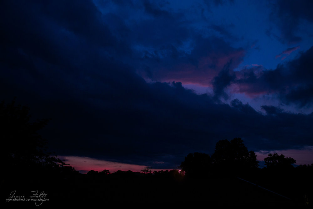 dark blue, black, and pink stormy North Carolina  sky during the end of sunset