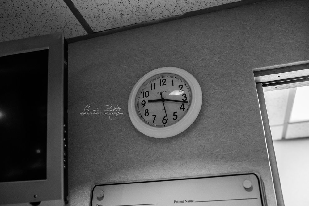 a clock reading 9:17 on a hospital wall