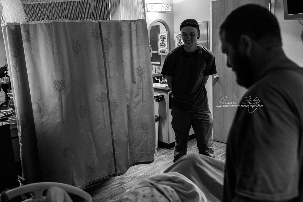 man smiling at best friend in labor