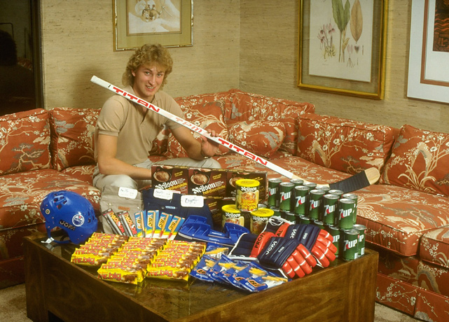 siphotos :     Today is Wayne Gretzky's 51st birthday. In this 1981 photo, Gretzky poses in his Edmonton home with sticks, helmet, equipment, and other products he endorses. (Paul Kennedy/SI)    GALLERY:   Rare Photos of Wayne Gretzky   SI VAULT:   Gretzky, 17, tearing up Edmonton (12.11.78)      Proving Jagr didn't corner the market — or even open in the market — on mullets.
