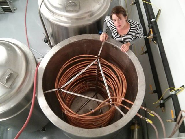 Amy inspecting the glycol chiller.