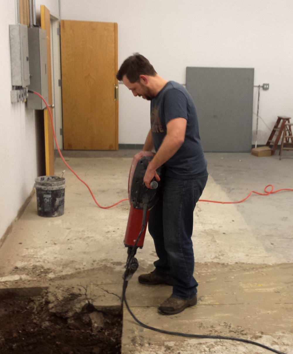 Cesar prepping for the floor drain way back in the spring.