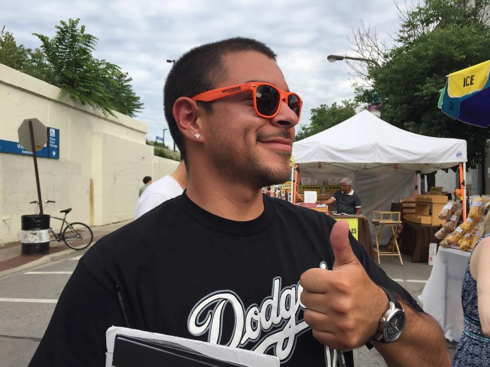 A fan modeling our new sunglasses @ Custer Street Fair 2015