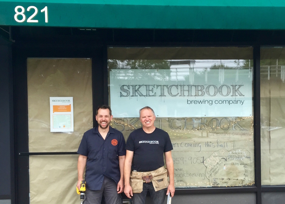 Cesar and Shawn in front of new storefront