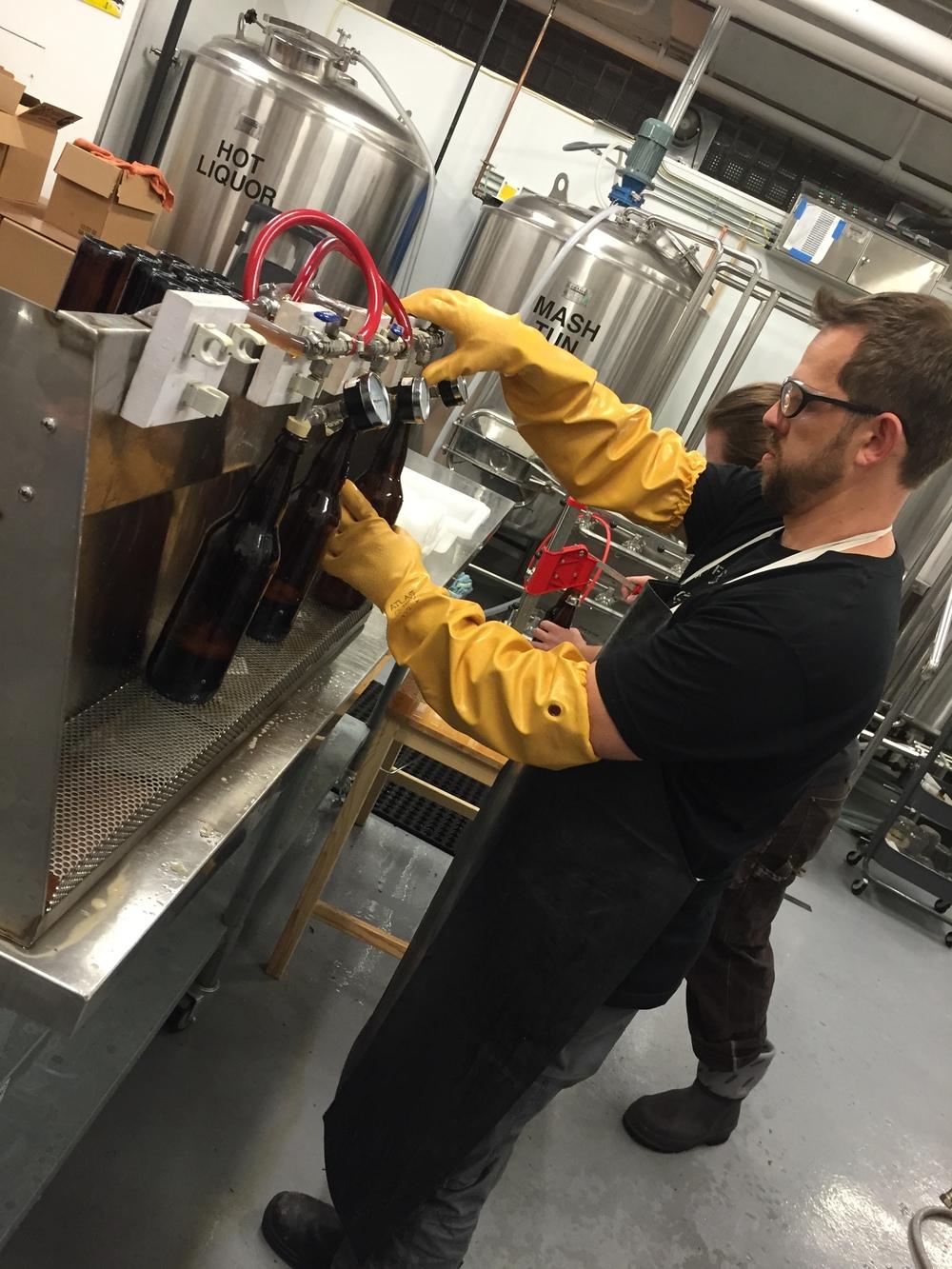 Cesar fills our first bottles (9/15)