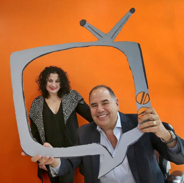 The Kitchen's Vice President Deeny Kaplan, left, and President and CEO Ken Lorber goof around at the language-dubbing company's Miami offices in Edgewater.