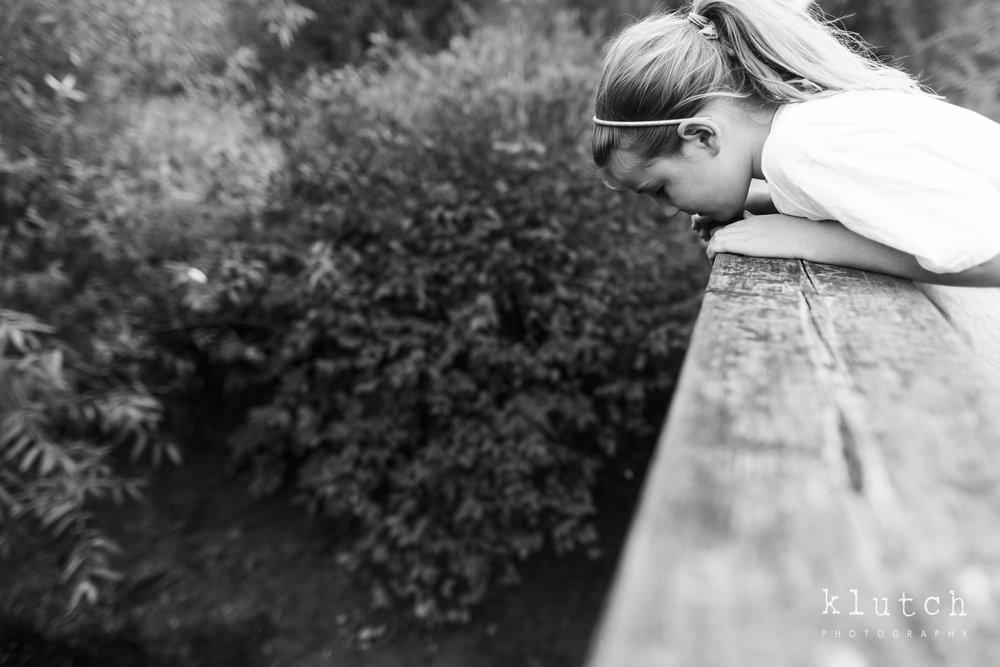 girl looking in water