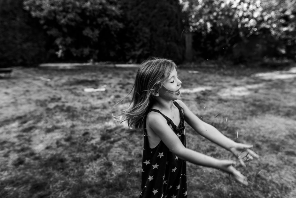 Surrey Family photographer. Vancouver family photographer, klutch Photography, documentary photography, candid photography, throwing grass