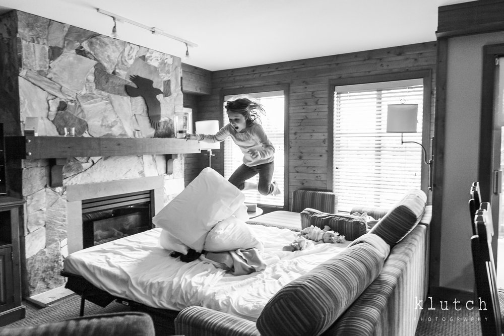 Girl jumping on bed-Surrey Family Photographer. Vancouver family photographer, klutch Photography, documentary photography, Vancouver documentary photographer, candid photography, lifestyle photographer, a day in the life session, family photography, Vancouver Photographer, Surrey Family Photographer, White Rock family Photographer, Dina Ferreira Stoddard-6151.jpg