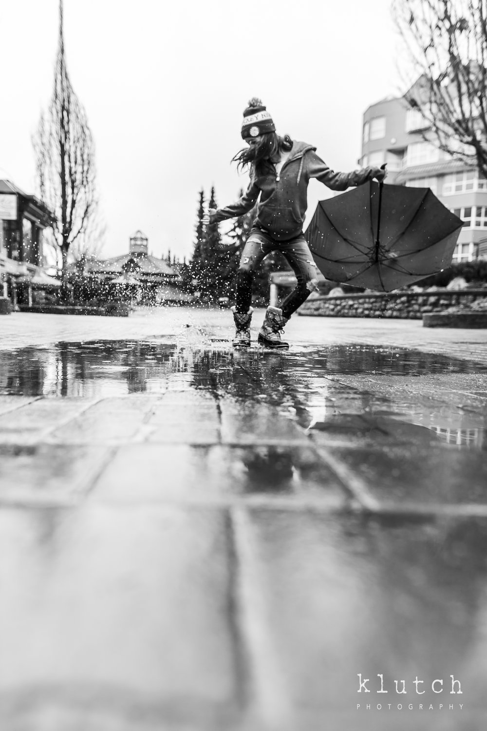 girl jumping in puddle-Surrey Family Photographer. Vancouver family photographer, klutch Photography, documentary photography, Vancouver documentary photographer, candid photography, lifestyle photographer, a day in the life session, family photography, Vancouver Photographer, Surrey Family Photographer, White Rock family Photographer, Dina Ferreira Stoddard-6380.jpg