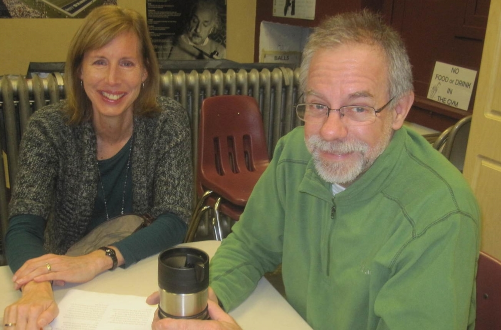"Deb Saxon and Rick Armstrong attend the Sunday morning """"Reading Scripture in Community"" group"