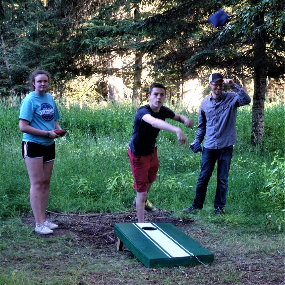 Daniel, Lena, and Aaron corn-holing