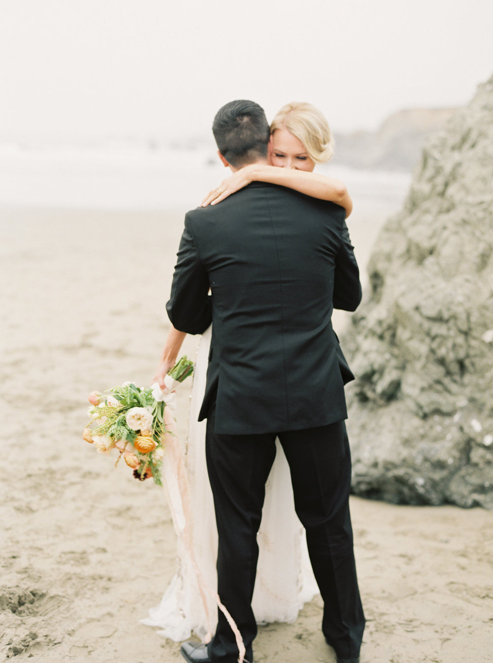 WilderFloralCo_CoastalElopement_BrideAndGroomOnBeach