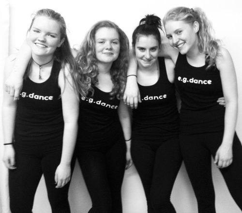 Claire (second from left) with fellow dancers and her sister, Katie (left)