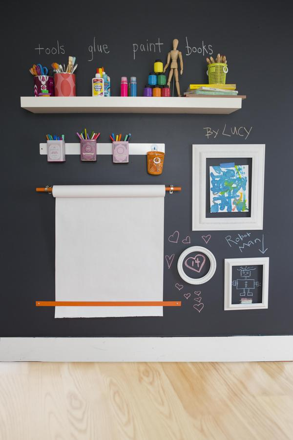 stimulate creativity with this imaginative wall mounted art station   Chalk paint:  Target   Similar wall mounted paper roller system:  Crate & Barrel   Wall mounted storage options:  Wayfair  ,  Container Store