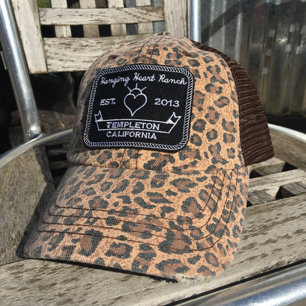 Leopard Hat with Patch $25 Adjustable leopard print trucker hat with brown mesh. Hanging Heart Ranch patch sewn on.