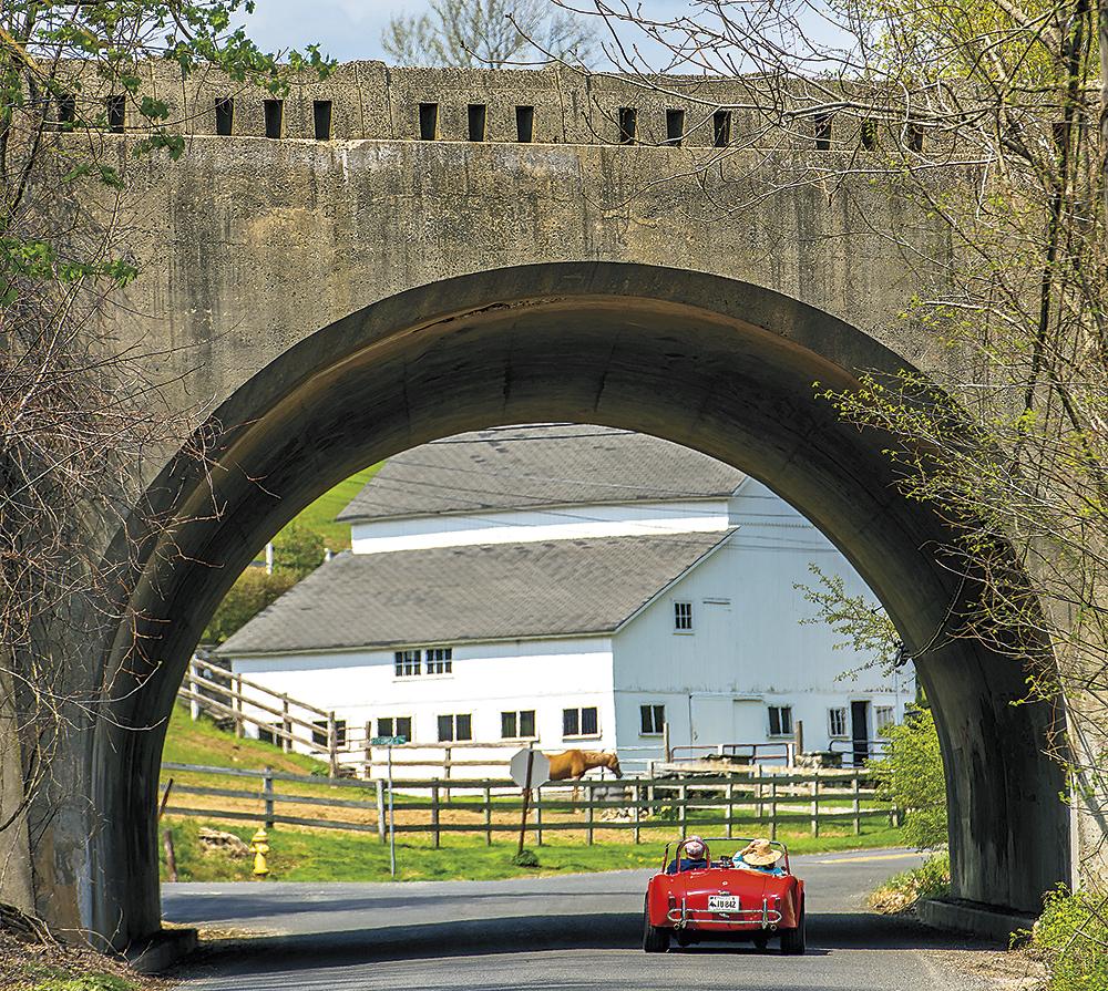 MacInnises-cruising-under-bridge