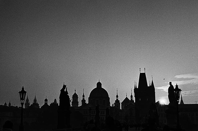 TODAY our Czech republic has 100th birthday and I made this photograph as a present for her, for us. It's a special occurrence which only happens about 2-4 times a year, on a place 5x5 cm on the Charles Bridge, when all towers, statues, lamps and sunrise align in one spectacular scenery. I love the optimism an early morning bird flew in to give it.  I made 3 handmade darkroom prints from film to GIVEAWAY signed, so if you'd like to hang one on your wall, just let us know and I'll be happy to pick 3 of you. Happy birthday to our country (and my grandma, whose birthday is today as well🖤)! Shot on my beloved 1955 Leica M3 and Kodak Tri-x, enlarged on my favorite heavyweight matte baryta Ilford paper.  @leica_camera @kodak @ilfordphoto