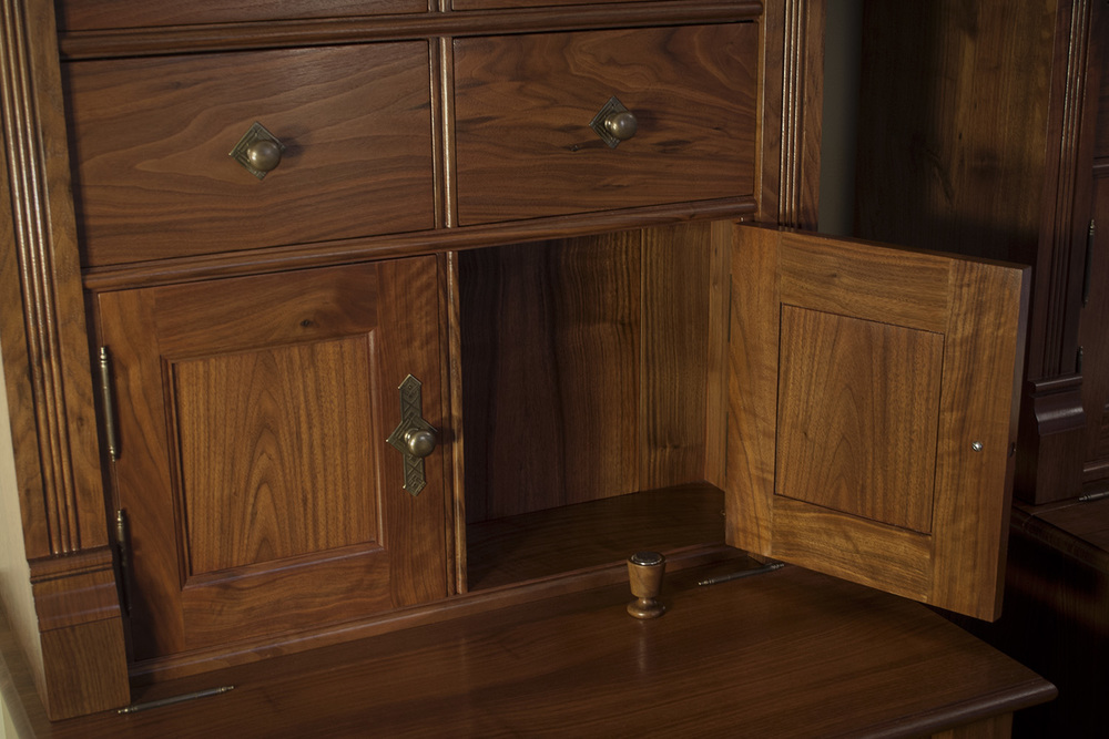 Traditional-Walnut-Bookcases-secret-compartment.jpg