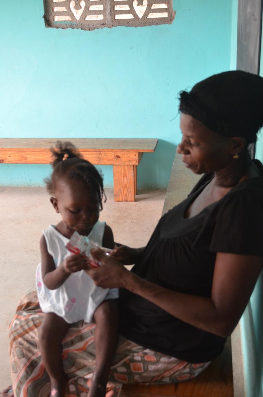 Shenaida's auntie helps her eat Mamba