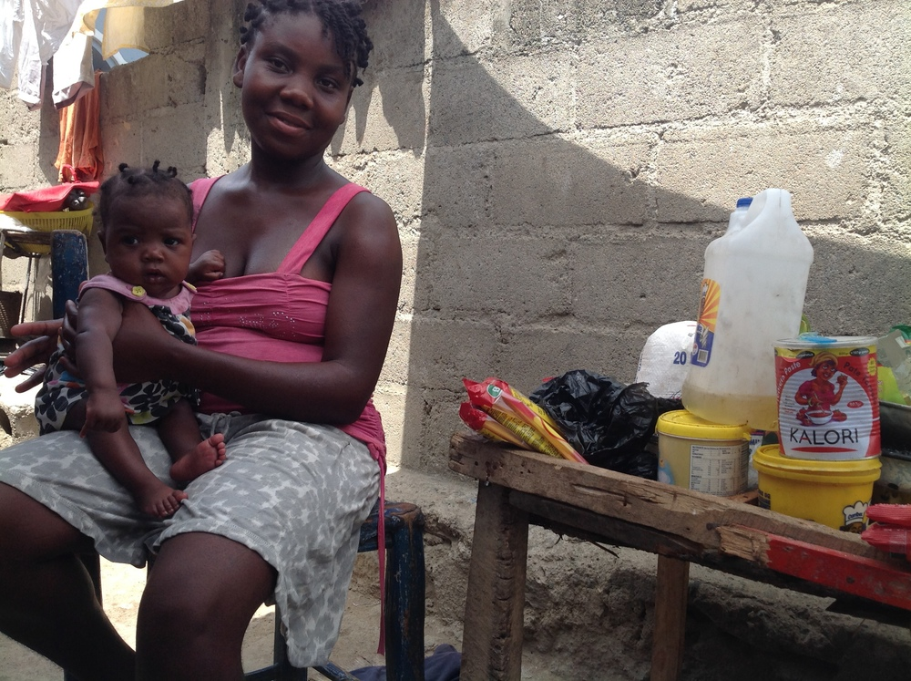 This mom was at Second Mile for 10 weeks. Here she is with her 6 month old healthy daughter selling goods in front of the home she shares with her parents and siblings.