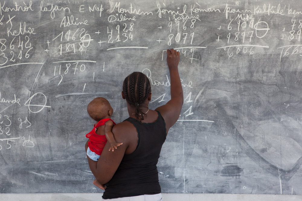 Caregivers at Second Mile Haiti take part in afternoon literacy class.