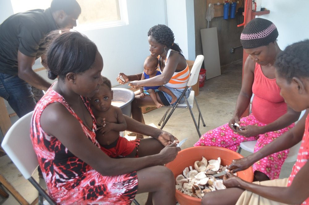Second Mile mothers assist with coconut preparation