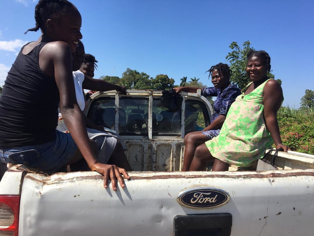 During the week of lockdown, women have been getting creative with transportation to the Strong Start Maternity Center, doing anything necessary to make sure their pregnancies are on track. Here women ride in a truck that will only be able to take them so far on backroads before they reach roadblocks and have to descend on foot.
