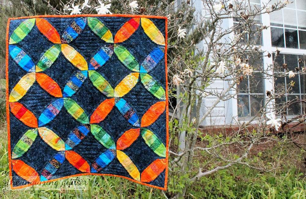 I used foundation piecing and fabrics from the Pressed Petals collection to make my mini quilt for March's Mini Madness