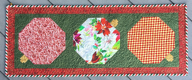 This lovely Merry Berry Table Runner was created by Nancy @ Grace and Peace Quilting!