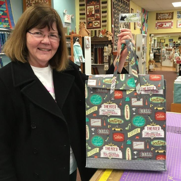 Kathy Shouten made this bag using Girls Night Out fabric (designed by  Terri Degenkalb , a local fabric designer) and the  On the Town Shopper Bag pattern  (a free download from Windham Fabrics).