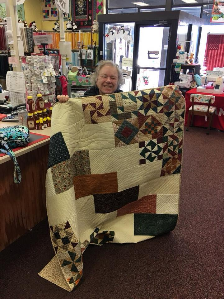 Gillian White brought this quilt in recently. Love the setting, with the blocks in the corners. What a clever idea!