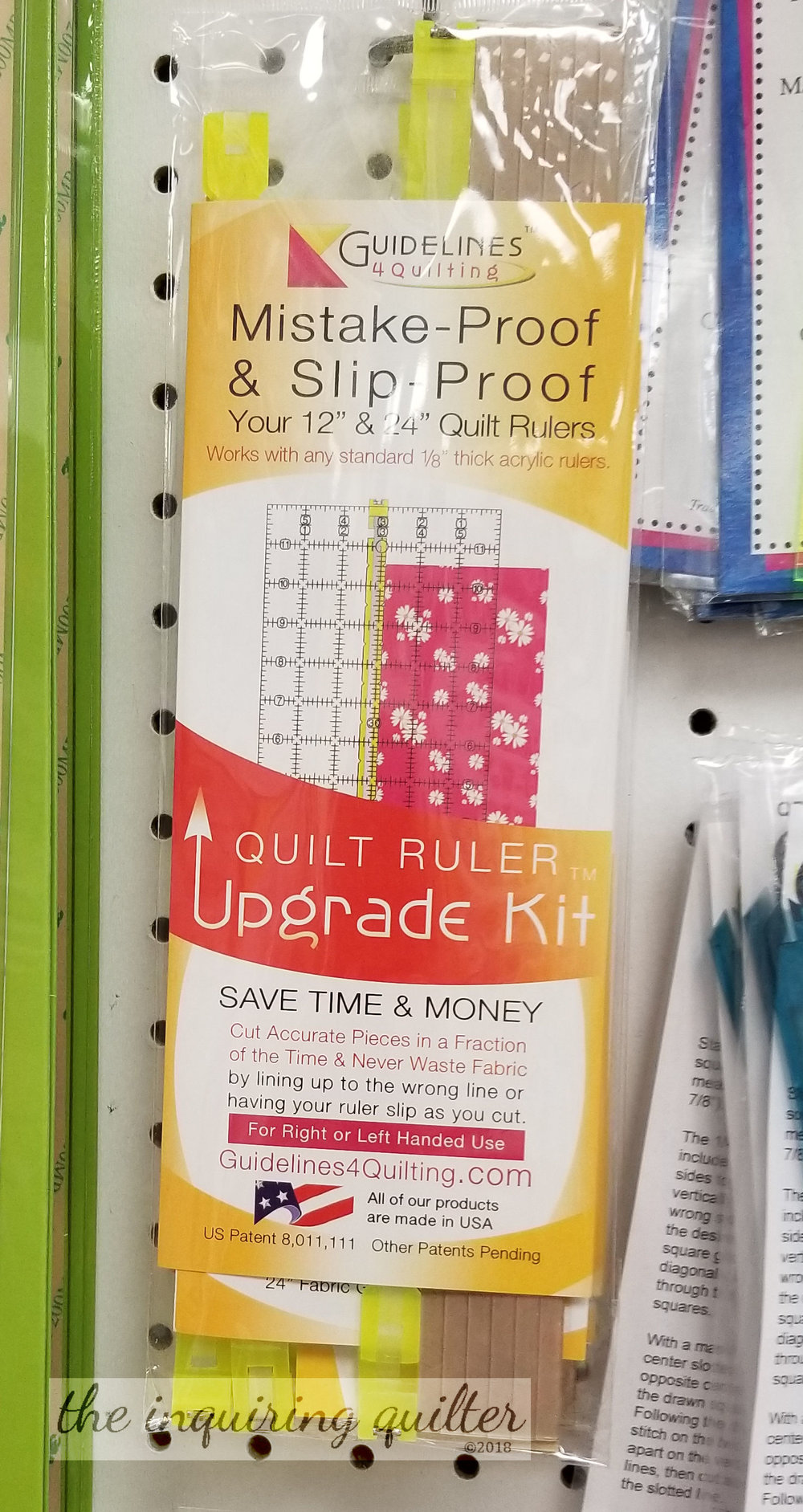 "Ever try to cut a bunch of 2-7/8"" squares? This gizmo hooks onto your ruler, providing not only a visual guide but an edge that perfectly aligns your fabric. Haven't tried it yet, but I think it's cool."