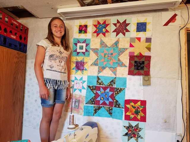 Deana her niece Abby and her quilt.jpg