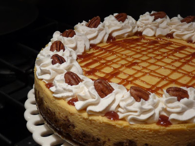 Pure Pumpkin Cheesecake - ButterYum. pumpkin cheesecake recipe. thanksgiving cheesecake idea. autumn cheesecakes. cheesecake recipe with pumpkin.