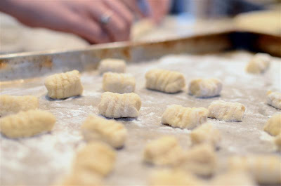 Place the gnocchi in a single layer on a floured sheet pan and repeat the process until you've used up all the dough.  The gnocchi are now ready to be cooked.