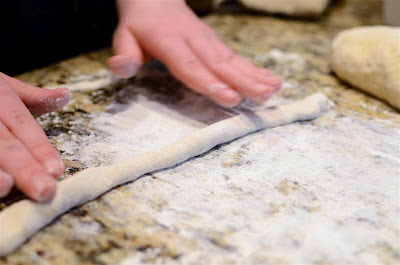 The dough is kneaded a few times.  Then take a hunk of dough and roll it into a snake that's 3/4-inch thick.