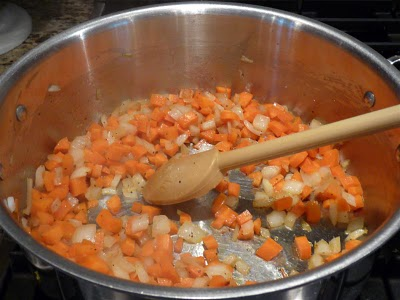 Saute the onions and carrots in 1 tablespoon of olive oil until softened and beginning to caramelize.